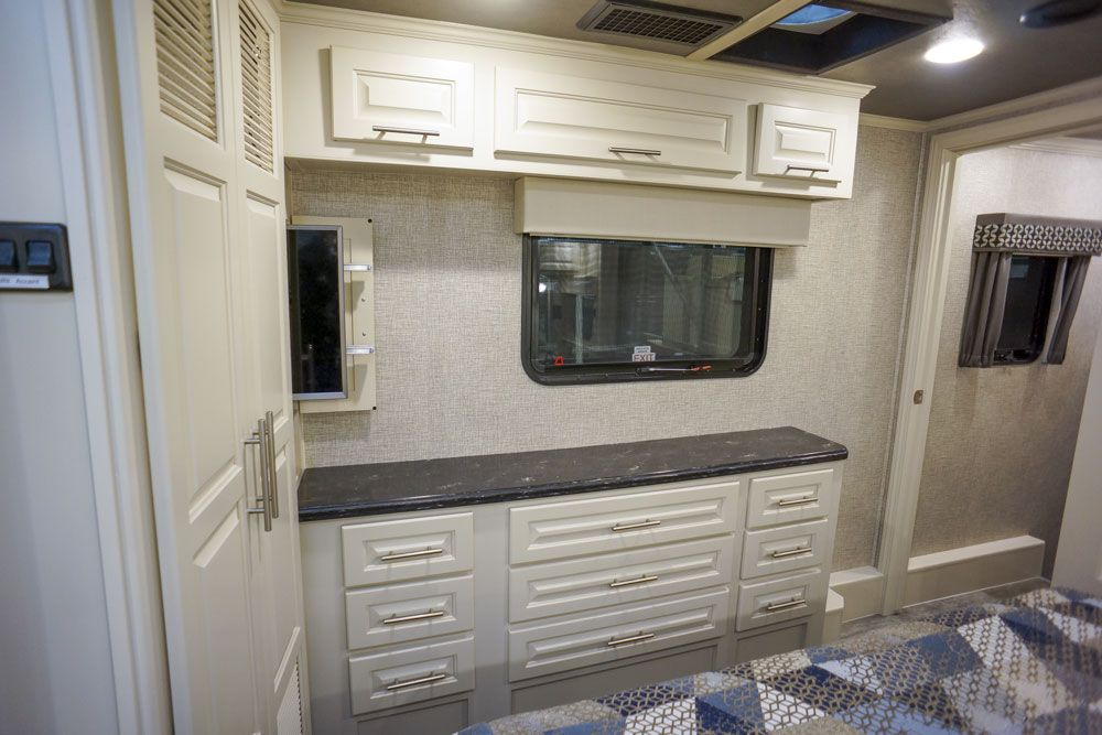 Luxury toy hauler bedroom slide out TV 32 view