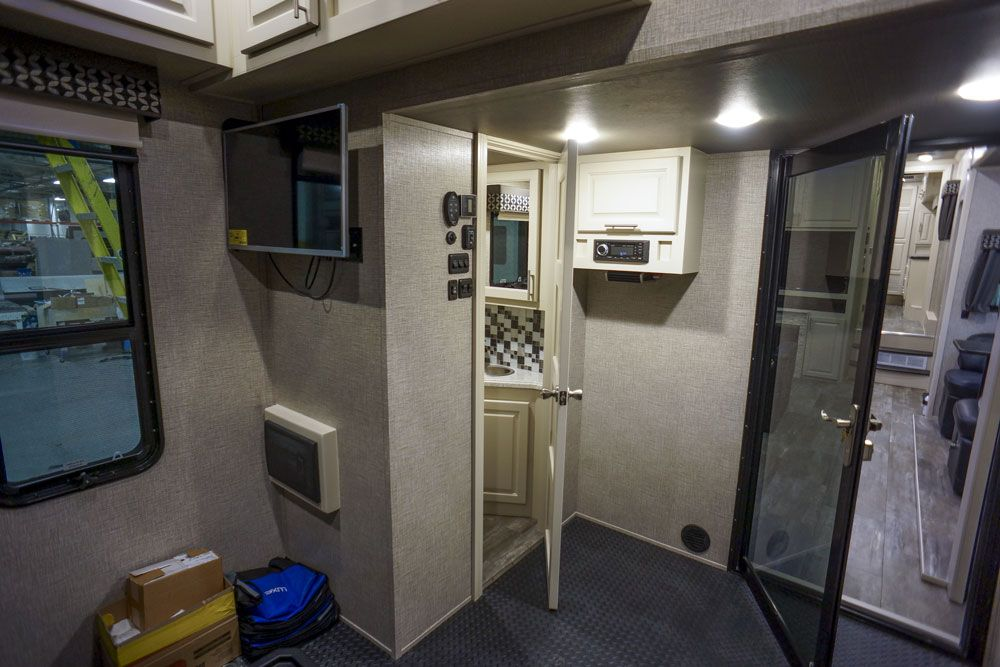 Luxury toy hauler garage half bath