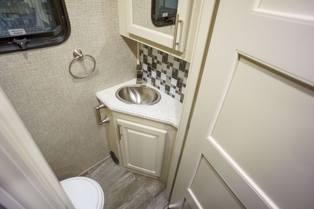 Luxury toy hauler garage half bath sink